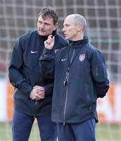 New USMNT assistant Lubos Kubik rubs his hands in grim determination while Coach Bradley discusses crushing somebody's head.