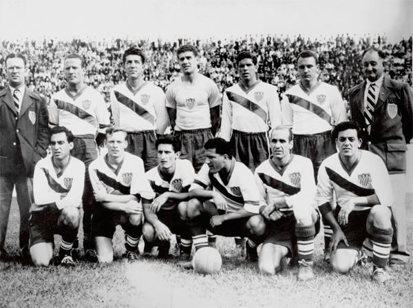 The US team that defeated England at the 1950 World Cup. (back row, l-r) manager Chubby Lyons, Joe Maca, Charlie Colombo, Frank Borghi, Harry Keogh, Walter Bahr, coach Bill Jeffrey; (front row, l-r) Frank Wallace, Ed McIlvenny, Gino Pariani, Joe Gaetjens, John Souza, Ed Souza