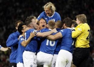 Harrelson beats England & real soccer news