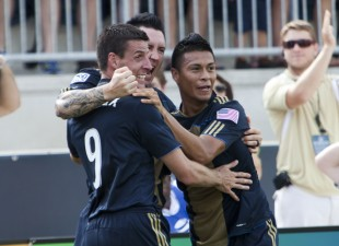 Michael Orozco, Danny Califf and Sebastien Le Toux celebrate a goal vs. Toronto. (Photo: Daniel Gajdamowicz)