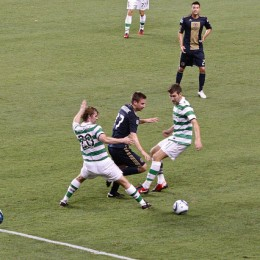 J.T. Noone splits two defenders against Celtic. (Photo: Paul Rudderow)