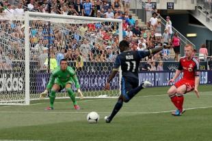 Freddy Adu lines up the shot...