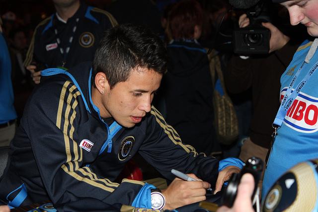 Roger Torres signing for a fan