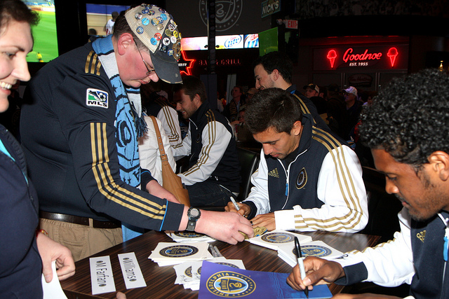 Michael Farfan and Sheanon Williams cranking out signatures