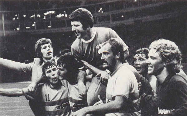 Jubilant Atoms players carry coach Al Miller after the win. Photo courtesy nasljerseys.com.