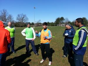 """Rafael explains his """"stage 3"""" exercise to the class, while Antonio takes notes"""