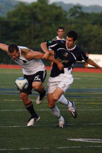 Matt Hedges battles Alejandro Moreno for possession in the inaugural friendly in 2010. (Photo Credit: Rachel Boscov)