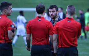 Chambers confronts officials following the full time whistle.