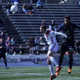 Matt Real leaps above a Richmond midfielder.