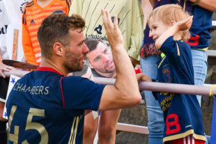 James Chambers high five's a young fan there to celebrate his 100th game.