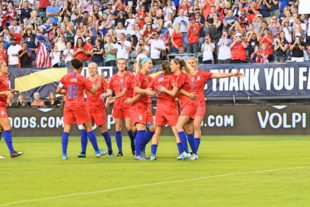 The US Women celebrate the first goal of the game.