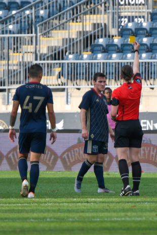 Zach Zandi is shown a yellow card by the Head referee. This is one of 7 yellow cards given out at this game with 2 to Ben Ofeimu resulting in a red card and him leaving the game.