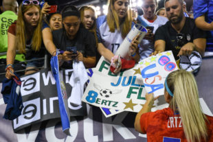 Julie Ertz takes time so sign autograghs and thank fans for coming to the game to support them.