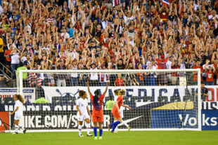 Fan celebrate with the US Team after a goal in the 2nd half.