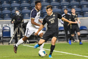 OSCAR PEREIRA from Army, works on a pass before Navy's Diego Manrique puts too much pressure on him.