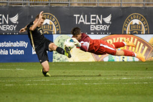 Goalkeeper for Navy, Ian Bramblett, blocks the shot taken by KEENAN O'SHEA.