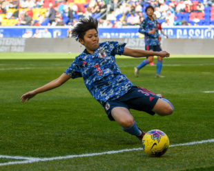 Shiori Miyake from Japan tries to save the ball from going out of bounds with a slide tackle.