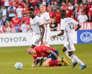 A trio of Union players, Jamiro Monteiro, Warren Creavalle, and Jakob Glesnes, all ignore Zdenek Ondrasek who is clearly in pain on the field.