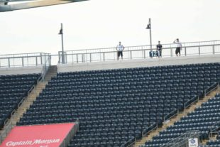 Union II staff socially distancing in the empty stadium. Courtesy of Sean Griswold