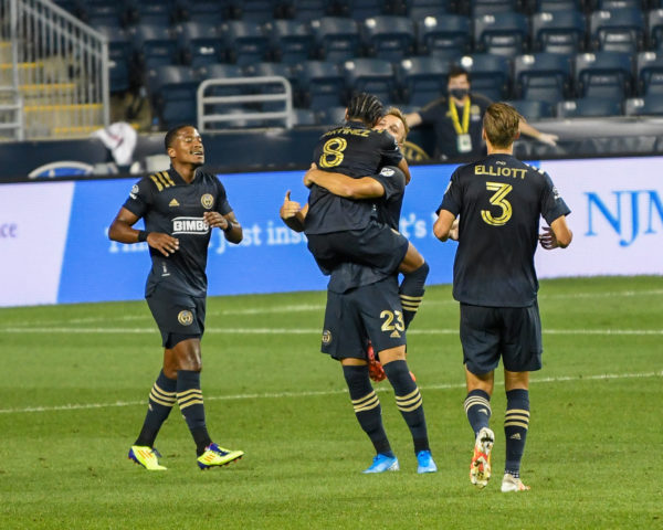Jose' Martinez jumps in the arms of Kacper Przybylko after Kasper scored his second goal of the evening.