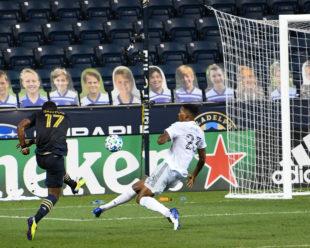 Donovan Pines, DC United, attempts to stop Sergio Santos, Philadelphia Union, shot on goal. Sergio scores!