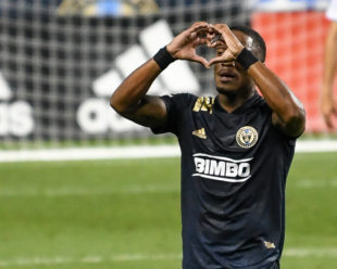 Sergio Santos send out his love after his goal in the first half.