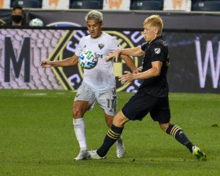 Jakob Glesnes, Philadelphia Union,  works on his defense against Yamil Asad, DC United.