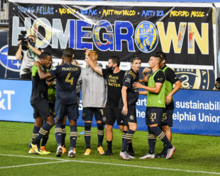 Brenden Aaronson celebrates with his teammates, many Homegrown Players, after his goal taking the Union to a 4-1 lead against DC United.