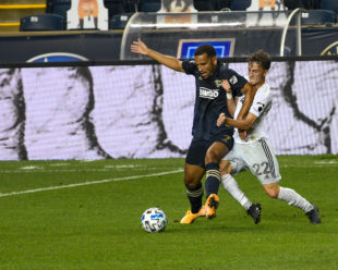 Griffin Yow, DC United, is trying to use physicality to wind the ball from Andrew Wooten, Philadelphia Union.