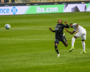 Santos responds to Reyes stomping on his foot as he was coming down the field for a shot on goal.