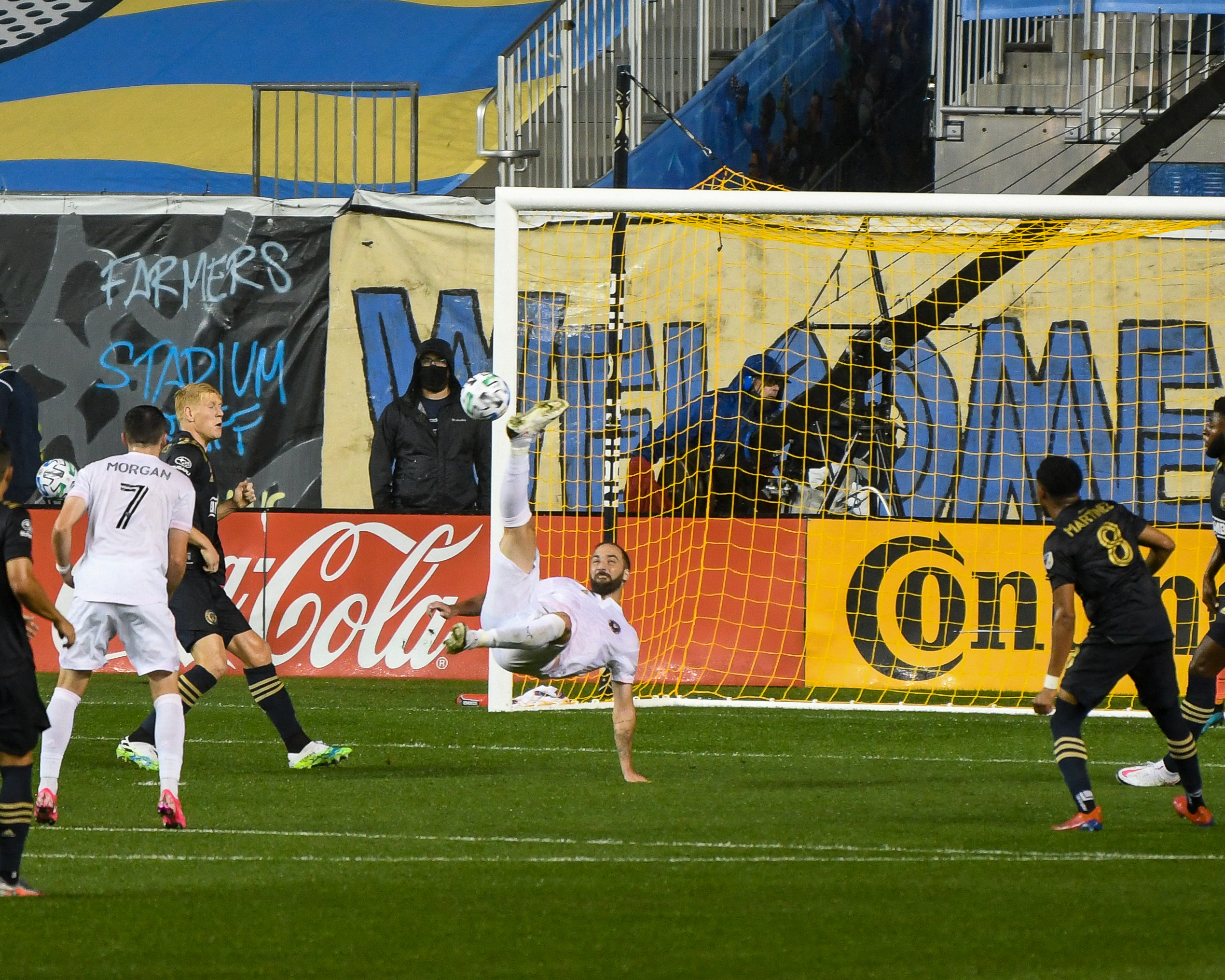 In his MLS debut, Gonzalo Higuaín goes for the bicycle kick but hits the post.