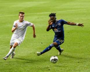 Patrick Bohui works to keep the ball for the Union II.