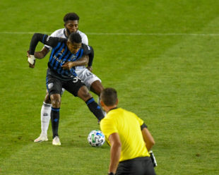 Mark McKenzie and Romell Quioto are physical in their battle for the ball. This play ends with Quito elbowing McKenzie and receiving a red card after VAR review.
