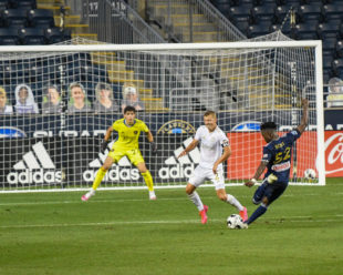 Patrick Bohui takes a shot on goal against Vicente Reyes, Making his USL Debut, during the first half of the game against Atlanta United II.