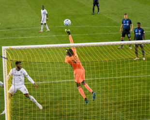 Andre Blake punches the ball to save a goal.