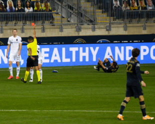 A red card is shown to Chicago Fire's Francisco Calvo in the first half after fouling Alejandro Bedoya.