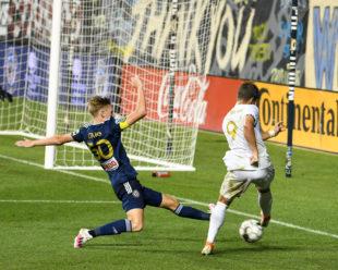 Branon Craig defends a shot towards goal.