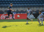 Brandon Craig leaps through the air while Red Bulls II defenders look on.