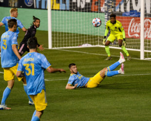 Kia Wagner makes a sliding save as a shot is taken by Inter Miami in the first half.