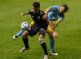 Alejandro Bedoya works to get his foot on the ball while defending Jay Chapman.