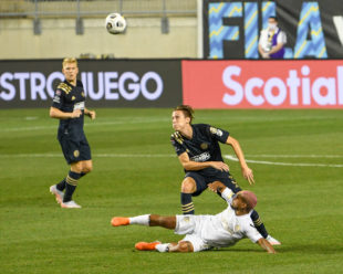 Jack Elliot has his eyes locked on the ball as Josef Martinez goes the the ground during the challenge for the ball. Jack received a yellow card for this play.