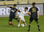 Matt Real and Marcelino Moreno fight for the ball during the second half of the game.