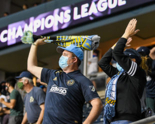Fans stand, clap, swing scarves and make noise to get the boys in the blue through the final minutes.