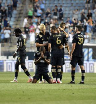 Sergio Santos give thanks as the team celebrates his goal.