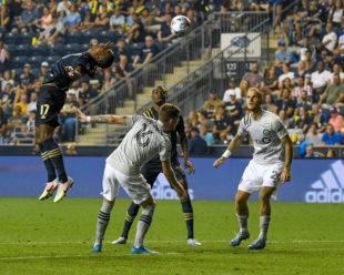 Sergio Santos sends the ball over  Joel Waterman and Karifa Yao.