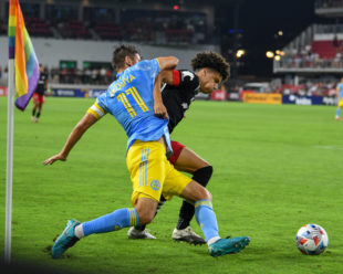 Kevin Paredes works to beat Alejandro Bedoya to the ball, taking away any chance at a goal.