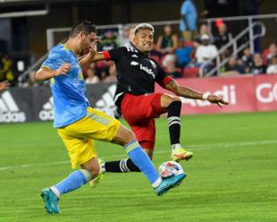 Alejandro Bedoya take a shot on goal as Antonio Alfaro tries to block the attempt.